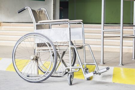 patients: old wheelchair for patients Stock Photo