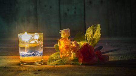 candlelit: Classic flower and candlelit relax.still life