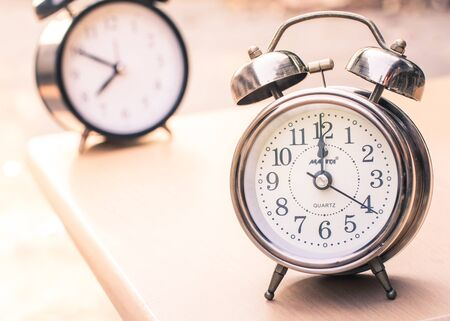 pace: Vintage style with old alarm clock and the pace of life.