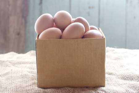 brown box: Eggs are packed in brown box