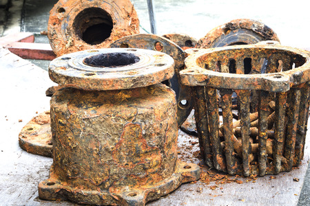 diameter: Detail and texture of the Rusty steel water supply pipe.