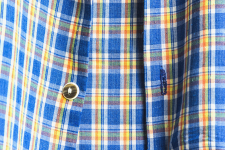 checkered polo shirt: Blurred image of a plaid shirt. Abstract background.