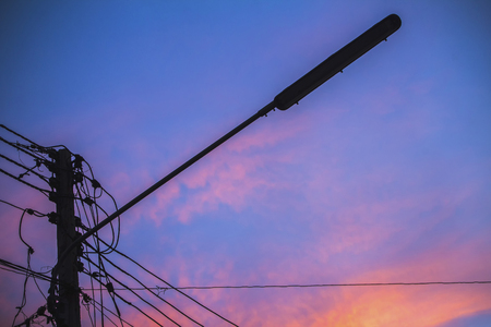clutter: Silhouette line wire clutter with colorful sky at sunset.