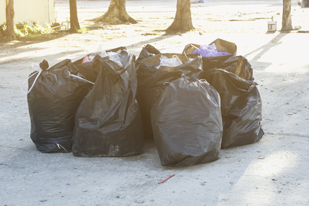 black plastic garbage bag: Garbage placed in a black plastic bag for disposal. Stock Photo