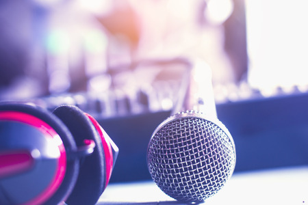 handlers: Analog microphone with recording equipment in the control room. Stock Photo