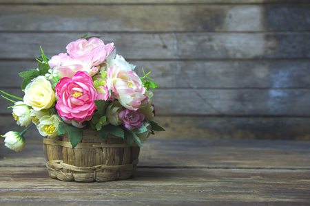 Flowers in a vase old wooden table.