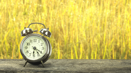 Golden clock on a wooden table. Stock Photo