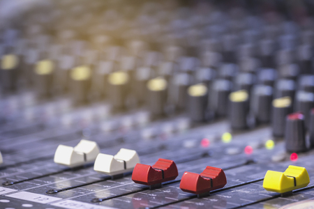 Mixer level control knob in the control room and sound recorder. 스톡 콘텐츠