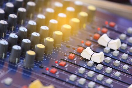 Mixer level control knob in the control room and sound recorder. Stock Photo