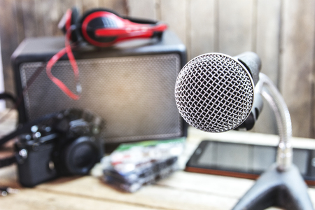 Analog microphone on a wooden table. Stock Photo