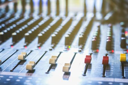 Slide the volume control of the audio mixer in a recording studio. Stock Photo