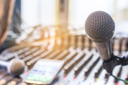 The microphone on the audio mixer. In the recording studio. Banco de Imagens