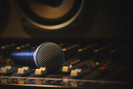 Microphone with audio equipment in the studio.