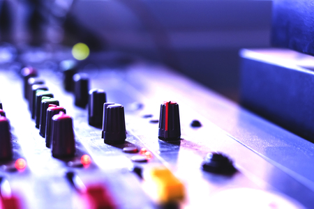 Closeup of a microphone button control system engineering professionals. Bokeh background. Stock Photo