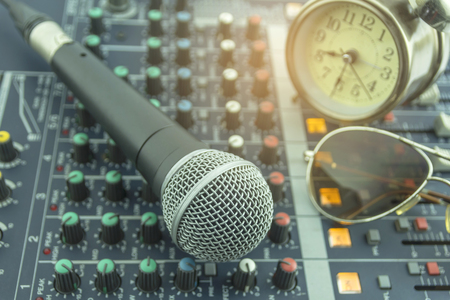 Microphone with recording room equipment. Stock Photo