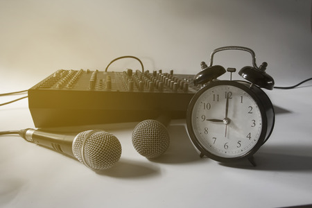 Microphones and retro watches with audio mixers. Stock Photo