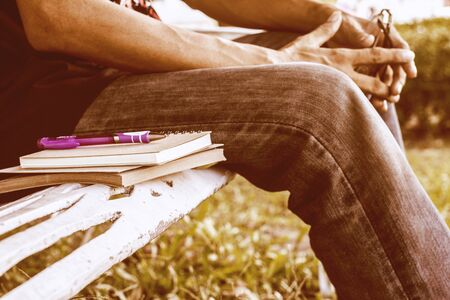 Diary of memories. Notebook and pen on steel benches in the park. Stock Photo