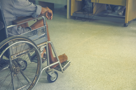 Patients sitting on wheelchairs waiting for the doctor in the hospital.