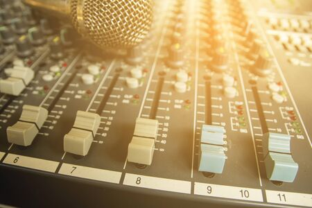 Slide the volume control of the audio mixer. Stock Photo