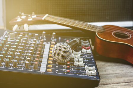 Microphones with audio mixer, sound recorder and old instrument. Stock Photo