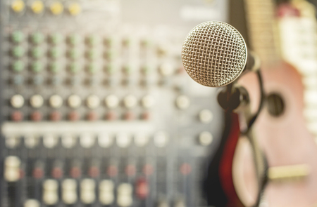 Microphone in room with recording device.