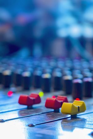 Slide the button to adjust the volume mixer of audio professionals. In the studio recording.