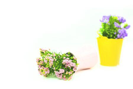 Vintage artificial flowers in a vase.