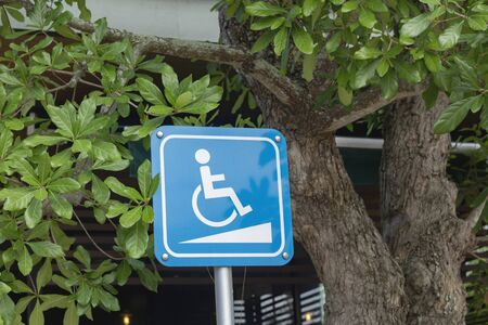 Blue sign indicating the path of the disabled.