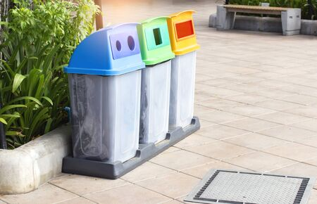 Plastic bins, yellow, blue, red, green. Separation of waste using color as the determination.