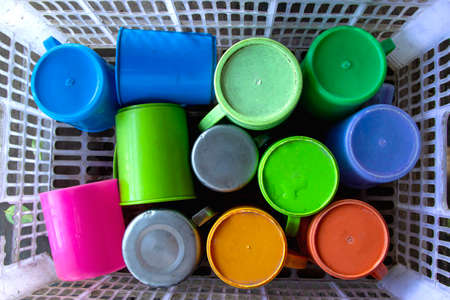 Plastic tumbler, aluminum tumbler in the basket.