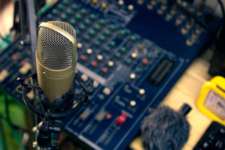 Condenser microphone on the console Professional recording equipment.