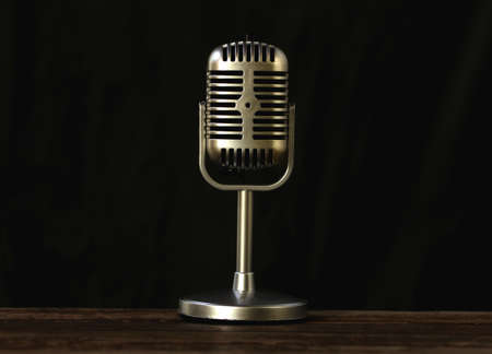 Vintage microphone on a wooden table.