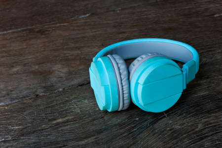Blue headphones on the wooden floor.