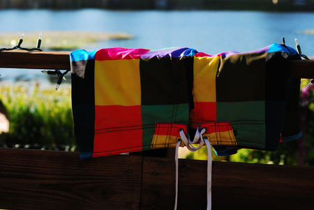 Colorful swim  trunks drying on the deck