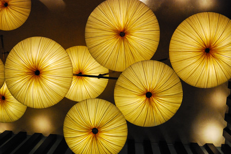 Lighted umbrellas from below with partial framing
