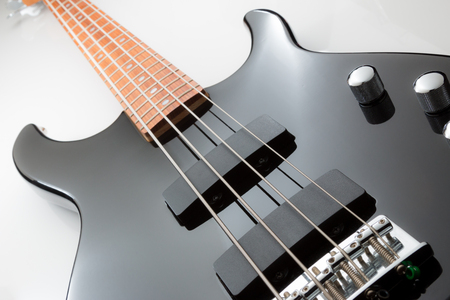 Electric Bass guitar, black with chrome hardware.