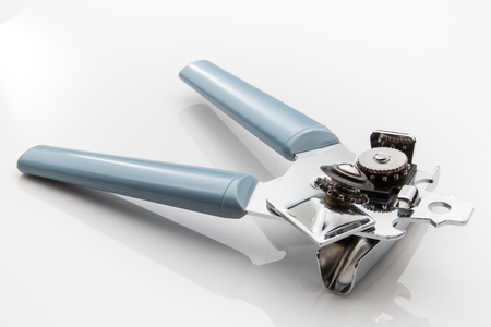 Can opener and bottle opener with blue handles. Stock Photo