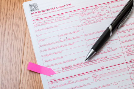 Medicare insurance form with pen on a desk.