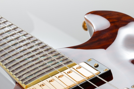 Electric guitar close up of strings and pickup and fretboard. Stock Photo