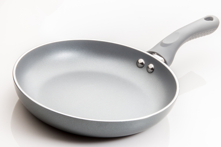 Frying pan with non stick finish on white background.