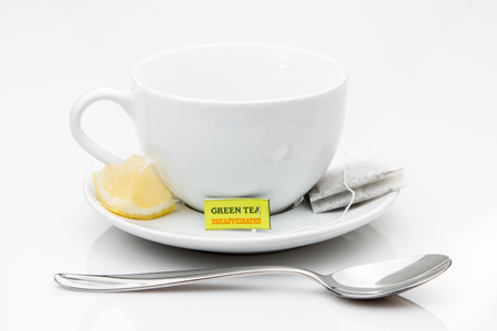 decaffeinated: Green tea and lemon wedge with cup and saucer. Stock Photo