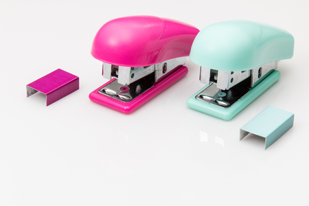 attached: Mini Staplers with staples in pink and green.