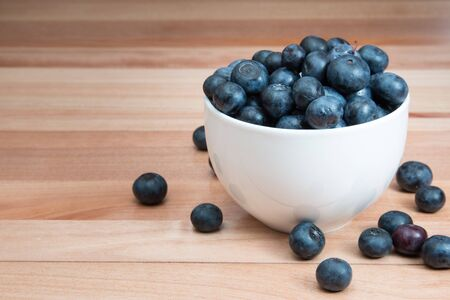 Blueberries in a bowl on a table.