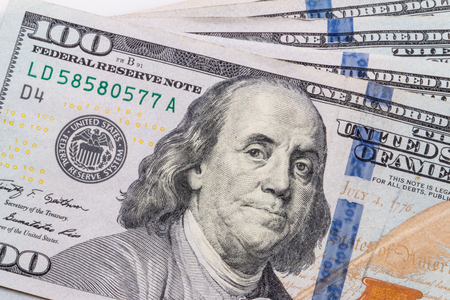 money packs: One hundred dollar bills in U.S. currency.