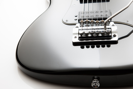 Electric guitar on a white background.