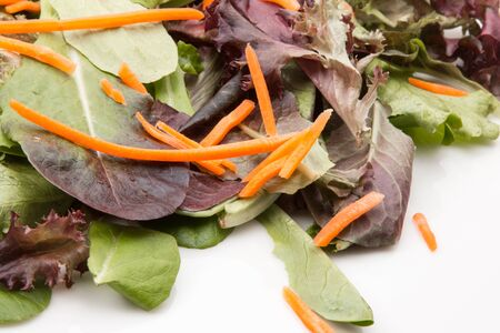Salad green and carrots with spinach and arugula. Imagens