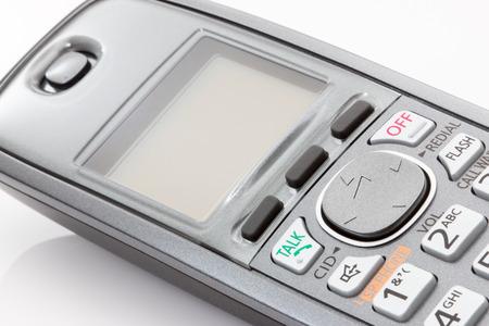 白い背景に受話器をコードレス。