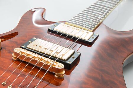 Electric guitar with gold pickups. Stock Photo