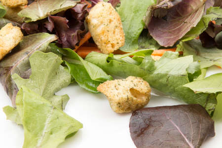 Salad greens with croutons.