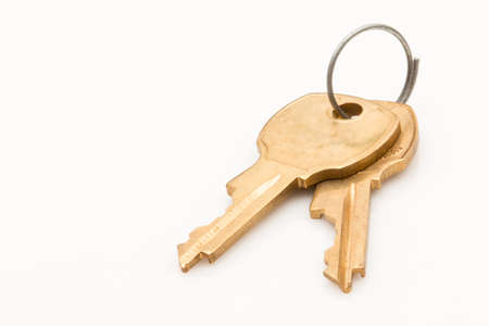 Two keys on a key ring on white background. Stock Photo